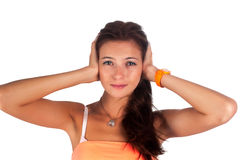 Hear no evil. Young pretty woman covering her ears Stock Photos