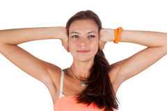 Hear no evil. Young pretty woman covering her ears Royalty Free Stock Photo