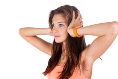 Hear no evil. Young pretty woman covering her ears Royalty Free Stock Photos