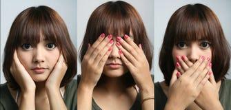 Hear no, see no, speak no. Asian Beautiful lady in hear no, see no, speak no pose Stock Photo