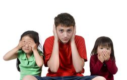 Hear no, speak no, see no evil. Three children do the old proverb see no evil, speak no evil, see no evil Stock Photos
