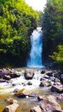Secret hidden waterfall hidden away in Maui Hi Full Royalty Free Stock Images