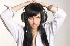 Hear you. Pretty young girl with headphones Stock Photography