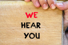 We hear you text concept Stock Image