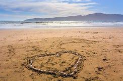 Heard hizo de seashels en la playa Imagenes de archivo