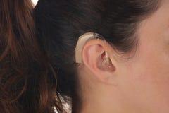 Hearing Aid. Beautiful young woman with Hearing Aid, closeup shot royalty free stock photo