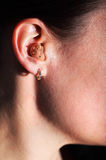 Hearing-aid. Young caucasian woman with hearing-aid Royalty Free Stock Photo