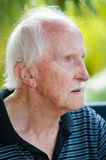 Hearing Aid. Portrait of very old man wearing hearing aid; behind the ear (BTE) fitting Stock Photography