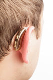 Hearing aid. On the man's ear closeup stock photo