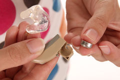 Hearing aid and battery Royalty Free Stock Image