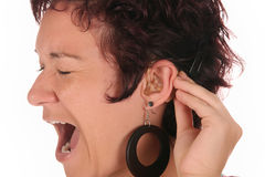 Hearing aid and battery Royalty Free Stock Photos