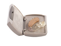 Hearing aid in box. Hearing aid with it's box isolated on white stock photography