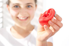 The hearing aid for a child stock images