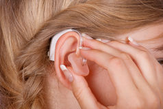 Hearing aid close up with ear Stock Photography