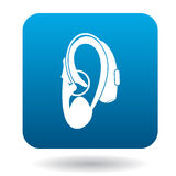 Hearing aid on an ear icon icon, simple style Stock Image