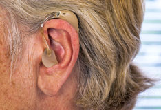 Hearing aid, ear royalty free stock image