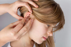 Hearing aid fitting process. Royalty Free Stock Photo
