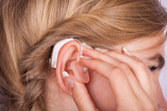 Hearing aid inserting Stock Images