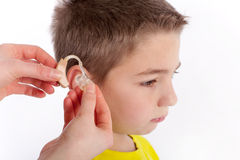 Hearing aid inserting Royalty Free Stock Photos