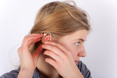 Hearing aid inserting Stock Image