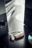 Hearing aid and music speaker. Royalty Free Stock Photos