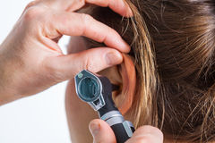 Hearing check-up. A professional hearing check-up at the doctor's stock images