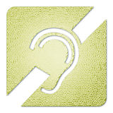 Hearing impaired icon. Textured metallic plate with the symbol of a human ear indicating hearing handicap or impairment Royalty Free Stock Photos