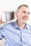 Hearing impaired man trying to listen radio Stock Image