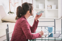 Hearing impaired woman working with tablet Royalty Free Stock Photos