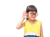Hearing. Little asian girl in hearing action royalty free stock photo