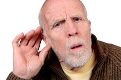 Hearing Loss. An elderly man with his hand to his ear trying to hear Royalty Free Stock Photo