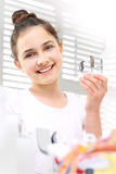 Hearing loss in children. The girl chooses the model hearing aid in the study of hearing prosthetics royalty free stock photos