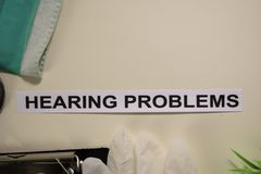 Hearing Problems with inspiration and healthcare/medical concept on desk background stock photography