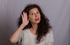 Hearing problems in mature woman Stock Images