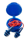 Hearing Protection. Close-up shot of blue ear plugs with red cord in blue canister Royalty Free Stock Images