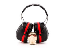 Hearing protection earmuffs. On a small model head on a white background Stock Photo