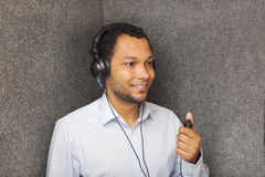 Hearing Test. Young man in audiology booth doing a Hearing Test Royalty Free Stock Photos