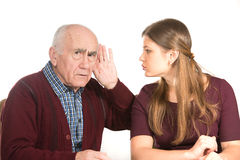Hearing test. Young women makes hearing test for old senior man Stock Photo