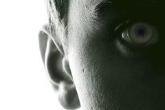 Hearing and vision. Half face MAN with `shadow and light GAME stock photography
