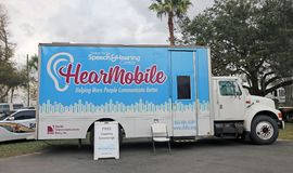 Hearmobile Vehicle In Florida State Fairgrounds. Hearmobile vehicle offers a free hearing screenings Stock Photos