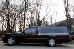 Hearse. A black new hearse on the street Stock Photos