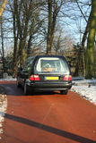 Hearse on a winter cemetery Royalty Free Stock Photo
