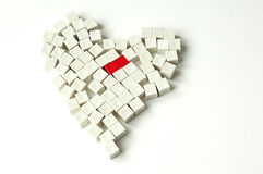 Heart. Made with white pieces of a children ruler, with just one red piece in the middle Royalty Free Stock Photo