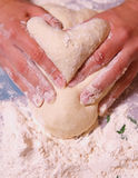 Heart. Moulded by hands from the dough Royalty Free Stock Photo