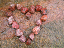Heart. Of stones on stone after rain Royalty Free Stock Images