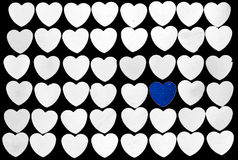 Heart. Rows of the white heart with one blue Stock Images