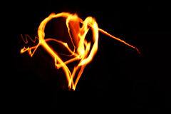 Heart. The flaming heart is burning in the dark Stock Photos