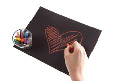 Heart. On paper on white background, hands and chalk Stock Photos