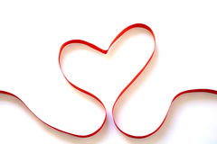 Heart. Red Heart in Ribbon in white background Royalty Free Stock Images