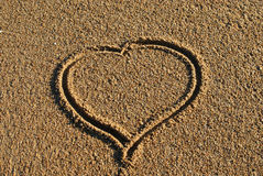Heart. Nice Heart drawed by hand on sand Stock Image